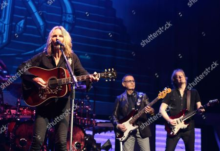 """Stock Image of Tommy Shaw, from left, Chuck Panozzo and James """"J.Y."""" Young of the band Styx perform in concert at the American Music Theater, in Lancaster, Pa"""