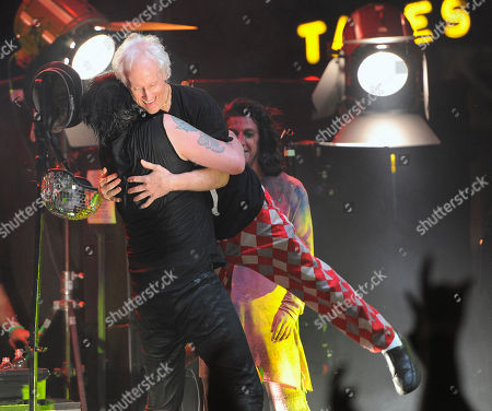 Robbie Krieger of The Doors, right, gets a hug from Marilyn Manson after they performed together at the Sunset Strip Music Festival, in West Hollywood, Calif