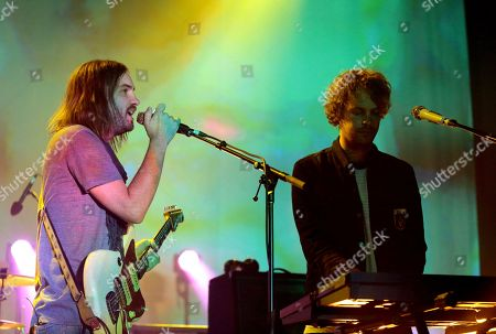 Kevin Parker, left, and Jay Watson of the band Tame Impala perform in concert during their Currents Tour 2015 at the Tower Theater, in Upper Darby, Pa