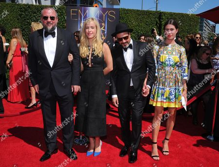 Shane Smith, and from left, guest, Eddy Moretti, and guest arrive at the Television Academy's Creative Arts Emmy Awards at the Nokia Theater L.A. LIVE, in Los Angeles