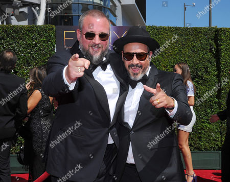 Shane Smith, left, and Eddy Moretti arrive at the Television Academy's Creative Arts Emmy Awards at the Nokia Theater L.A. LIVE, in Los Angeles