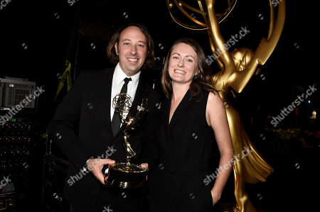 Schuyler Telleen, left, and Katherine Isom, winners of the award for outstanding production design for a variety, nonfiction, reality or reality-competition series for Portlandia, attend night two of the Television Academy's 2016 Creative Arts Emmy Awards at the Microsoft Theater on in Los Angeles