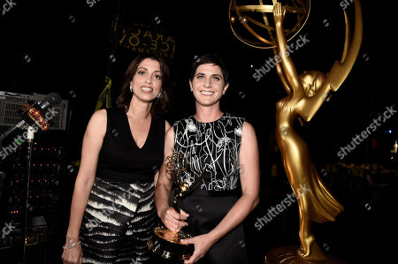 Laura Ricciardi, left, and Moira Demos attend night two of the Television Academy's 2016 Creative Arts Emmy Awards at the Microsoft Theater on in Los Angeles