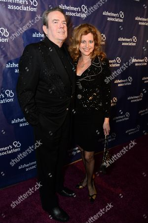 "Jimmy Webb, left, and Laura Savini arrive at the 22nd annual ""A Night At Sardi's"" to benefit the Alzheimer's Association at the Beverly Hilton Hotel, in Beverly Hills, Calif"