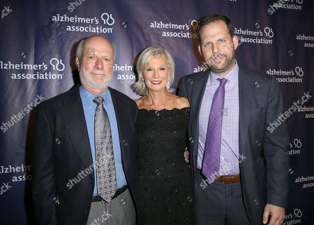 """Stock Photo of James Burrows, from left, Laurie Burrows Grad and Nicholas Grad arrive at the 24th annual Alzheimer's Association """"A Night at Sardi's"""" at the Beverly Hilton hotel, in Beverly Hills, Calif"""
