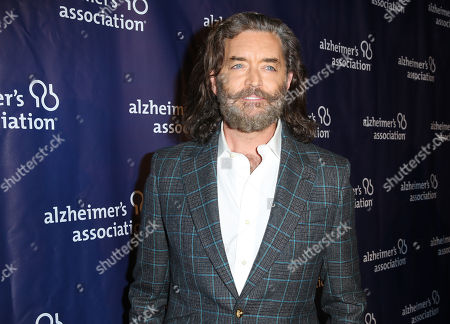"Timothy Omundson arrives at the 24th annual Alzheimer's Association ""A Night at Sardi's"" at the Beverly Hilton hotel, in Beverly Hills, Calif"