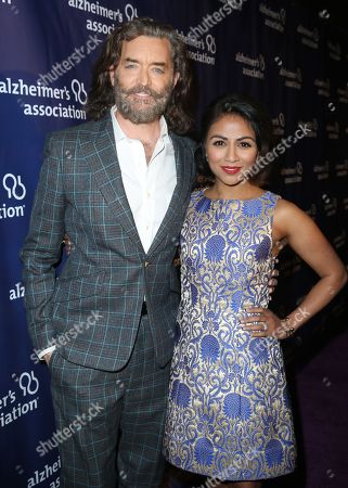 "Timothy Omundson, left, and Karen David arrive at the 24th annual Alzheimer's Association ""A Night at Sardi's"" at the Beverly Hilton hotel, in Beverly Hills, Calif"