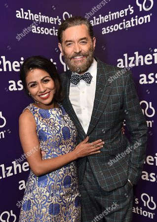 "Karen David and Timothy Omundson pose backstage at the 24th annual Alzheimer's Association ""A Night at Sardi's"" at the Beverly Hilton hotel, in Beverly Hills, Calif"