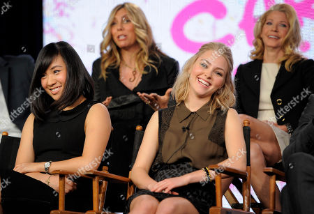 """AnnaSophia Robb, right, and Ellen Wong, left, cast members in the television series """"The Carrie Diaries,"""" and executive producers Amy B. Harris, top left, and Candace Bushnell, top right, take part in a panel discussion on the show at The CW Winter TCA Tour at the Langham Huntington Hotel, in Pasadena, Calif"""