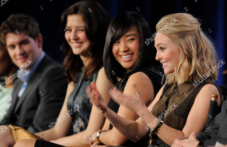 "Stock Image of AnnaSophia Robb, right, star of the television series ""The Carrie Diaries,"" answers a question as fellow cast members, from left, Brendan Dooling, Kate Findlay and Ellen Wong look on during a panel discussion on the show at The CW Winter TCA Tour at the Langham Huntington Hotel, in Pasadena, Calif"