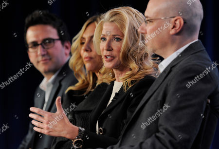 """Candace Bushnell, second from right, executive producer of the television series """"The Carrie Diaries,"""" makes a point as fellow executive producers, from left, Josh Schwartz, Amy B. Harris and Len Goldstein look on during a panel discussion on the series at The CW Winter TCA Tour at the Langham Huntington Hotel, in Pasadena, Calif"""
