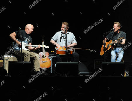 Musicians Bernie Leadon, left, Don Henley and Glenn Frey, right, of the Eagles perform at Madison Square Garden on in New York