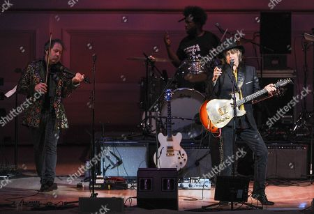 """Musicians Mike Scott, right, and Steve Wickham, of The Waterboys, perform at """"The Music of Prince"""" tribute concert at Carnegie Hall on in New York"""