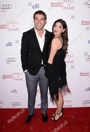 Actor James Wolk, left, and actress Amanda Setton attend the 2014 Television Academy Hall of Fame on in Beverly Hills, Calif