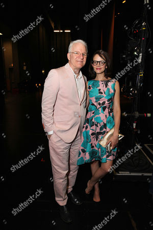 Stock Picture of From left, Steve Martin and wife Anne Stringfield pose during The Un-Private Collection: Eric Fischl and Steve Martin, an art talk presented by The Broad museum and held at The Broad Stage, in Santa Monica, Calif