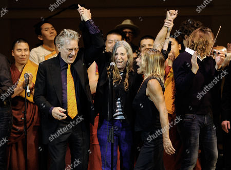 Co-founder of Tibet House U.S. Robert Thurman, left, singer Patti Smith and musician Iggy Pop perform at the 24th Annual Tibet House U.S. benefit concert at Carnegie Hall on in New York. Photo by Evan Agostini/Invision/AP