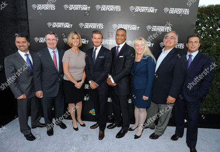David Beckham, fourth from left, and Time Warner Cable executives, left to right, Rob Marcus, Glenn Britt, Irene Esteves, David Rone, Melinda Witmer, Mike LaJoie and Jeff Hirsch attend the Time Warner Cable SportsNet and Time Warner Cable Deportes Networks launch event hosted by Time Warner Cable Sports, in Los Angeles