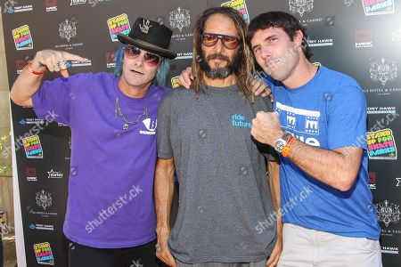 From left, skateboarders Kevin Staab, Tony Alva, and Andy Macdonald attend the Tony Hawk's 10th Annual Stand Up for Skateparks celebrity benefit on in Beverly Hills, Calif