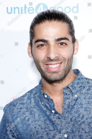 """Actor Jason Canela arrives at the Celebration of Local Heroes during unite4:good Day of Unity - Miami joining volunteers, celebrities and community leaders at the Ice Palace Film Studios on Monday, January, 20, 2014 in Miami, FL. unite4:good is the global movement for humanity whose mission is to inspire charitable action globally. With the support of local organizations and volunteers, the unite4:good movement launched in Miami and consisted in a variety of events and activities â?"""" ranging from painting murals in Overtown to organizing donated items at the Chapman warehouse helping homeless families. Miami-Dade County issued a proclamation deeming January, 20, unite4:good Day"""