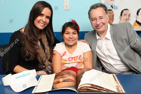 IMAGE DISTRIBUTED FOR unite4:good - Karent Sierra and Anthony Melikhov, Founder of unite4:good and global philanthropist, pose with a child at Amigos For Kids Reading Enrichment Program during unite4:good Day of Unity - Miami on Monday, January, 20, 2014 in Miami, FL. Unite4:good is the global movement for humanity whose mission is to inspire charitable action globally. Miami-Dade County issued a proclamation deeming January 20th unite4:good Day. Closing the day's activities with a celebration featuring award-winning recording artist Flo Rida
