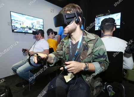 Keegan Allen playing Star Trek: Bridge Crew at Ubisoft E3 2016 - Day 2 at the Los Angeles Convention Center, in Los Angeles