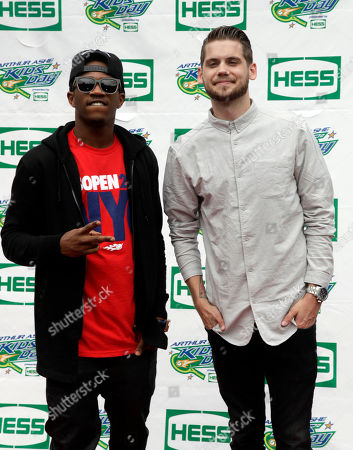 Recording artists Malcolm Kelly, left, and Tony Oller, right, of MKTO attend US Open Arthur Ashe Kids Day at the USTA Billie Jean King National Tennis Center on in New York