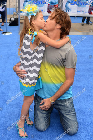 """Stock Picture of Dannielynn Marshall, left, and Larry Birkhead arrive at the world premiere of """"The Smurfs 2"""" at the Regency Village Theatre on in Los Angeles"""