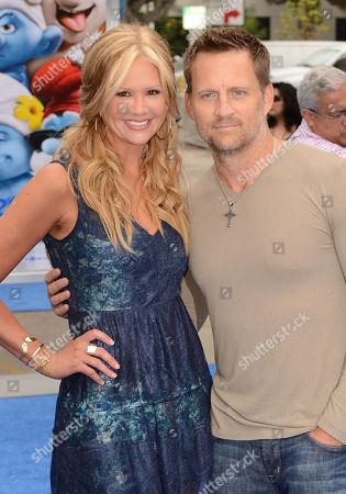 """Nancy O'Dell, left, and Keith Zubulevich arrive at the world premiere of """"The Smurfs 2"""" at the Regency Village Theatre on in Los Angeles"""