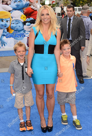 "Singer Britney Spears, center, and her sons Sean Federline and Jayden James Federline arrive at the world premiere of ""The Smurfs 2"" at the Regency Village Theatre on in Los Angeles"