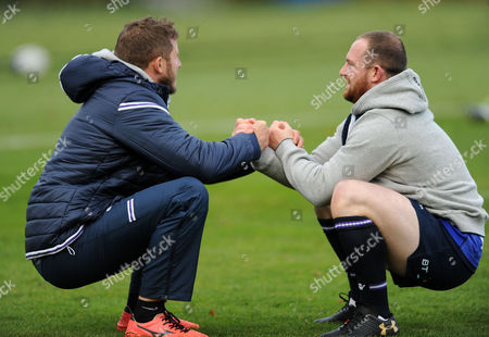 Nick Grigg - Scotland centre (R) stretches off with the help of strength & conditioning coach Mark Robertson.