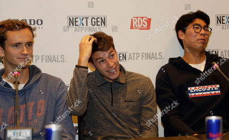 From left, U.S. Daniil Medvedev of Russia, Gianluigi Quinzi of Italy and Hyeon Chung of Korea, attend a press conference to present the ATP Next Gen Finals tennis tournament, featuring the eight qualifiers, in Milan, Italy