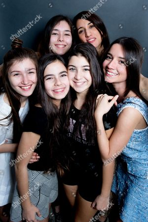 """Cast members Tugba Sunguroglu, from top left clockwise, director Deniz Gamze Erguven, Elit Iscan, Doga Zeynep Doguslu, Gunes Sensoy and Ilayda Akdogan from the film, """"Mustang,"""" pose for a portrait in West Hollywood, Calif. The 88th Academy Awards Best Foreign Language Film nominee """"Mustang"""" is a unique case, being a Turkish language and made film submitted for consideration by France, and also for being the only narrative feature nominated from a female director, Erguven. The Oscars will be presented on Sunday, Feb. 28, in Los Angeles"""
