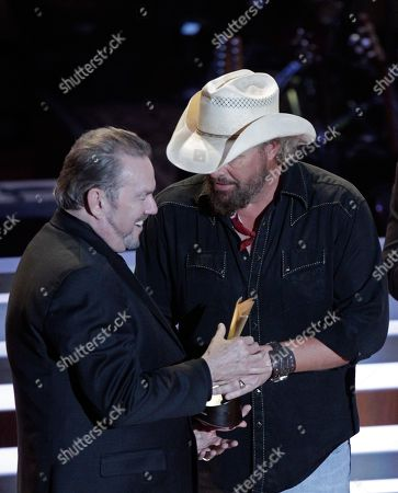 Jimmy Webb, left, receives the Poet's Award from singer Toby Keith at 10th Annual ACM Honors at Ryman Auditorium, in Nashville, Tenn