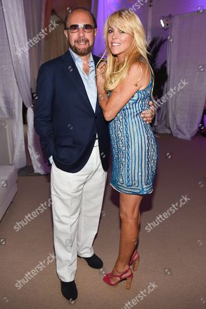 "Bobby Zarin, left, and Dina Lohan attend the 11th annual ""A Hamptons Happening"", benefiting the Samuel Waxman Cancer Research Foundation, at the Bridgehampton Estate of Maria and Kenneth Fishel, in New York"