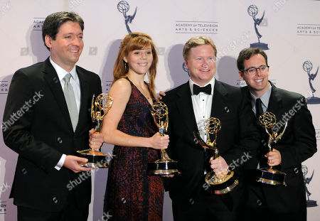"""Dan McCoy, Hallie Haglund, Kevin Bleyer and Elliot Kalan, from left to right, pose backstage with the award for outstanding writing for a variety series for """"The Daily Show with Jon Stewart"""" at the 2012 Creative Arts Emmys at the Nokia Theatre, in Los Angeles"""