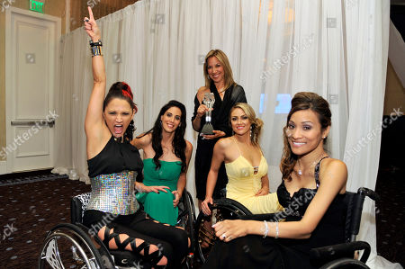 """From left, Angela Rockwood, Mia Schaikewitz, Gay Rosenthal, Tiphany Adams, and Auti Angel pose backstage with their award for best reality series for """"Push Girls"""" at the Critics' Choice Television Awards in the Beverly Hilton Hotel, in Beverly Hills, Calif"""