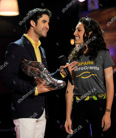 Actor Darren Criss presents an award to Sasha Fisher at the Do Something Awards at the Avalon, in Los Angeles