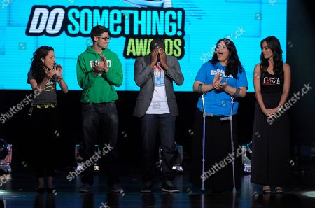 Daniel Maree, of Million Hoodies Movement for Justice, center, reacts after he is announced as the winner of the grand prize at the Do Something Awards at the Avalon, in Los Angeles. Looking on from right, Sasha Fisher, Ben Simon, Lorella Praeli and Jilian Mourning