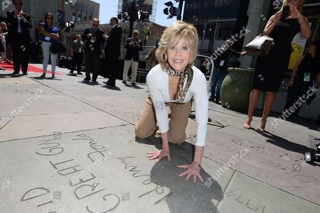 Jane Fonda compares her hands in her father, Henry Fonda's hand and footprint as the 2013 TCM Classic Film Festival honors Jane Fonda with a handprint and footprint ceremony at the TCL Chinese Theatre on in Los Angeles