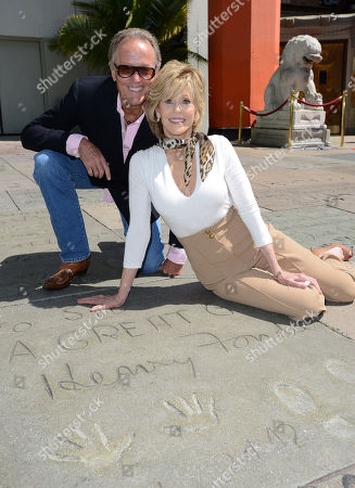 Jane Fonda, right, poses with her brother Peter Fonda in front of their father, Henry Fonda's hand and footprint as the 2013 TCM Classic Film Festival honors Jane Fonda with a handprint and footprint ceremony at the TCL Chinese Theatre on in Los Angeles