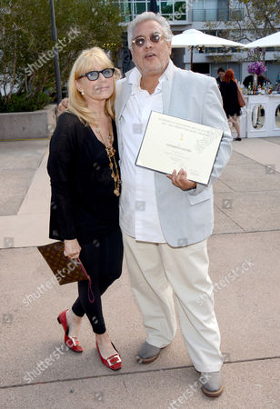 "Stock Image of Ellen Mirojnick, costumer designer of ""Behind The Candelabra"", left, and Eduardo Castro, costume designer of ""Once Upon A Time"", seen at the Television Academy's 66th Emmy Awards Costume Design and Supervision Nominee Reception at the Fashion Institute of Design & Merchandising, in Los Angeles"