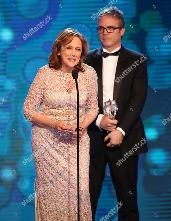 """Ann Druyan, left, and Brannon Braga accept the award for best reality series for """"Cosmos: A Spacetime Odyssey"""" at the Critics' Choice Television Awards at the Beverly Hilton Hotel, in Beverly Hills, Calif"""