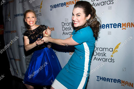 "Stock Picture of Lauren Worsham, right, and Anika Larsen pretend to fight over their shared award for ""Outstanding Featured Actress in a Musical"" at the Drama Desk Awards on in New York"