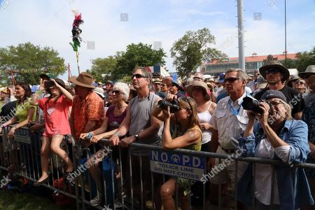 Stock Image of Fans take pictures as Alejandro Escovedo & the Sensitive Boys performs at the 2014 New Orleans Jazz & Heritage Festival at Fair Grounds Race Course, in New Orleans