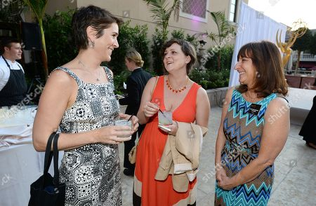 Heather Cochran, CFO & EVP business operations, and from left, Virginia Louise Smith and Susan Nessanbaum-Goldberg attend the Television Academy's 66th Emmy Awards Performers Peer Group Celebration at the Montage Beverly Hills, in Beverly Hills, Calif