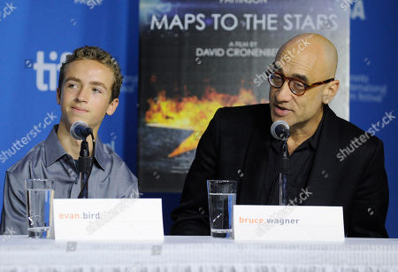 "Stock Picture of Evan Bird, left, and Bruce Wagner attend the press conference for ""Maps to the Stars"" on day 6 of the Toronto International Film Festival at the TIFF Bell Lightbox, in Toronto"