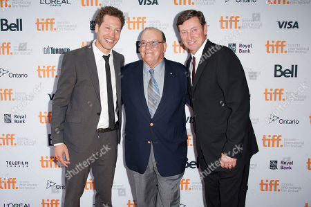 "Director Gabe Polsky, retired National Hockey League head coach Scotty Bowman and Wayne Gretzky seen at the premiere of ""Red Army"" at the Ryerson Theatre during the 2014 Toronto International Film Festival, in Toronto, Ontario"