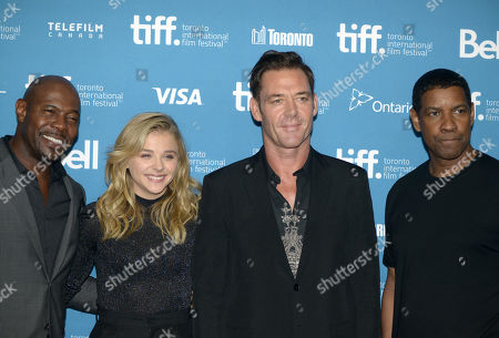 """Antoine Fuqua and from left, Chloe Grace Moretz, Marton Csokas and Denzel Washington attend the press conference for """"The Equalizer"""" on day 4 of the Toronto International Film Festival at the TIFF Bell Lightbox, in Toronto"""