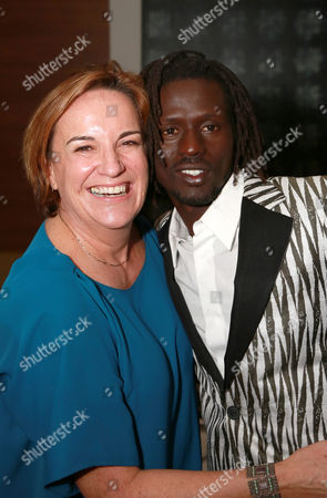 "Producer Karen Kehela-Sherwood and Emmanuel Jal seen at Warner Bros. ""The Good Lie"" Premiere at 2014 TIFF, in Toronto"