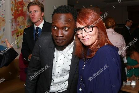 "Arnold Oceng and Writer Margaret Nagle seen at Warner Bros. ""The Good Lie"" Premiere at 2014 TIFF, in Toronto"